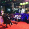 Me playing BF4 on stage with a fan during Paris Games Week 2013